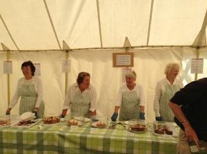 WI ladies dishing up cake.
