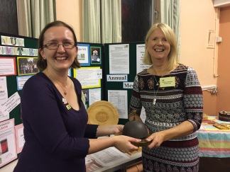 Lesley Guppy hands her President's bell to our new President Dinah Barrand (October 2017)